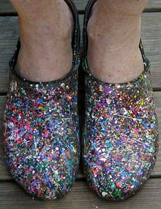 Who would paint their crocs with glitter?  This is terrible.  And those feet look like old lady feet...so what old lady would wear glitter crocs?!