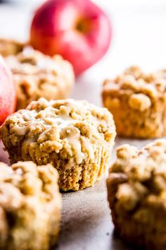 These apple cinnamon muffins are made better for you with plenty of healthy ingredient swaps! They have less sugar and oil than regular muffins and instead are loaded with Greek yogurt, whole wheat flour and maple syrup. Large apple chunks and a crumbly delicious oatmeal cinnamon streusel topping make them the best treat for fall! Try them for breakfast or brunch this weekend - and they'd be perfect for Thanksgiving, too! | #fall #muffins #recipe #apples #thanksgiving #baking