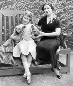 Queen Elizabeth II as a child with the Queen Mom and her Corgis.