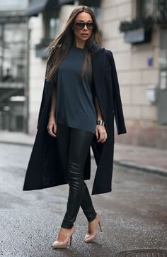 black long coat from LXLS, T-shirt from Lindex, leather trousers from David Lerner, and the shoes are from Christian Loboutin