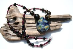 glass and garnet vintage love speckle by krixbeeble on Etsy. lovely <3