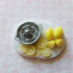 Lemon slice and whole lemons. Small prep board for dolls house kitchen, lemon squeezer and lemons on marble effect board. Polymer clay food. by MagentaMinis on Etsy