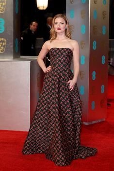 Flower power! Holliday Grainger dazzled in a fancy floral frock that she paired with a dramatic dark red lip. (Photo by Mike Marsland/Mike Marsland/WireImage)  via @AOL_Lifestyle Read more: https://www.aol.com/article/entertainment/2017/02/12/bafta-awards-2017-red-carpet-arrivals/21712310/?a_dgi=aolshare_pinterest#fullscreen