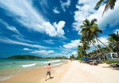 Unawatuna er en dejlig fiskerlandsby i Sri Lanka, og den har en fed strand med masser af muligheder for at spise på gode restauranter, bade og snorkle ved koralrev.