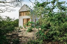 Nestled among the vegetation of the Oaxacan coastal town, the Puerto Escondido Concrete House makes the most of its modest footprint. The entire structure is formed from concrete, including the walls, gabled roof, floors, lofted sleeping platform, stairs, and kitchen...