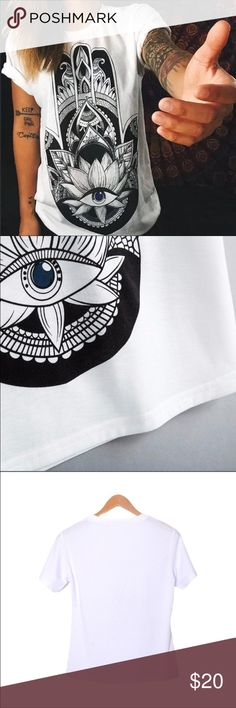 Hamsa Hand Eye of Fatima Black and White Tee Hamsa Hand Eye of Fatima Black and White Tee with Blue Eye. Thin see through material. Check the sizing chart. Fits more like a L Tops Tees - Short Sleeve