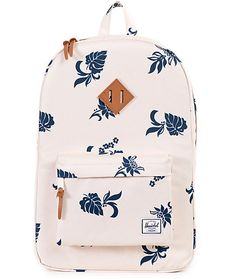 No bad days with the Herschel Supply Heritage Mid backpack designed with a floral pattern throughout so you can look and feel your best.