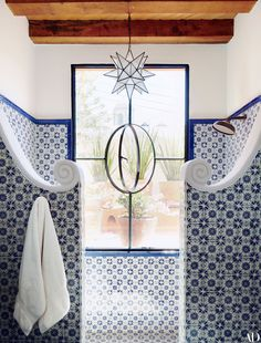 The tile in a guest bath of a San Miguel de Allende, Mexico, home by Fisher Weisman was produced in the nearby city of Dolores Hidalgo.