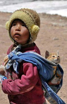 Baby baby wearing her kitten.. Inter species attachment parenting ;)