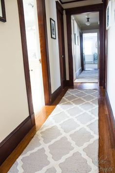 Two tan wool runners from Rugs USA completely transformed our upstairs hallway. Rug is the Moroccan Trellis in Tan.