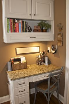 corner kitchen desk pull out drawer in top cabinet would be a great place for a power charging station great use of lights under the cabinet charging station kitchen central office