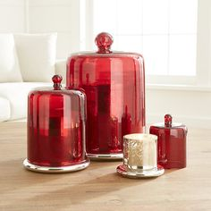 Shop Cinnamon Scented Candles.  Charming red glass cloche lifts up to reveal a beautiful antiqued silver candle holder filled with a handcrafted, cinnamon-scented candle.