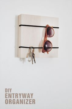 Need a place to hang your keys or slip your outgoing mail? Here's a quick fix. All you need is a wood framed box, two pieces of bungee and a drill. And all you really need to do is secure the bungee on the box. In five minutes, you'll have a simple bu