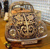 I'd hate to have this guy's auto insurance!  That's not paint you see there, it's 24k hand worked filigree, one wire at a time. O-:  (hat tip to B'sue's Boutique)