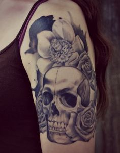 Done by the amazing Cory Hand at The Butcher tattoo studioin Savannah, GA. This is my dream tattoo and Cory did incredible work, I would recommend him to anyone. Three roses for past, present andfuture, one magnolia for my little girl and the skull as one of natures mostbeautiful and originalforms of art.