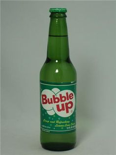 Bubble Up 12oz glass.JPG Bubble Up started being bottled by Dad's Root Beer in 1919 in Jasper, Indiana...that was a good ten yrs before its well known competitor, 7-Up. Famous for its strong lemon flavor, it's described as crisp/tart.