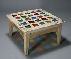 Concrete garden table, inlaid with hand-cast glass, and accented with stones, marbles, and shells.