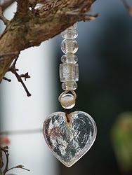 glass..I actually have very similar heart ornaments already...give them more impact on the tree with beads