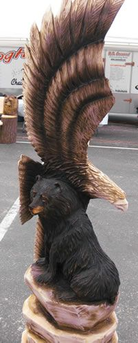 American Eagle & Bear ~ Carved by Echo Chainsaw Carving Team. #Eagle #WoodCarvings