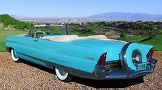 1956 Lincoln Premier Turquoise Blue Convertible with a Factory Continental Kit. |