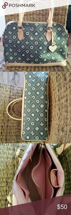 """Dooney and Bourke black and tan purse Dooney and Bourke black and tan purse.  Like new. In excellent condition.  Lots of pockets inside. Length of bottom is 14"""", height is 10"""". Dooney & Bourke Bags Satchels"""