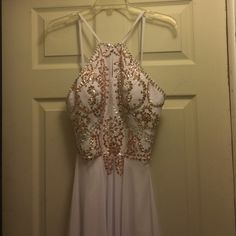 White prom/formal dress White and gold prom dress. Never worn because it was too small for me. Custom made so there are no tags. Can fit someone from a size 0-2. Dresses Prom