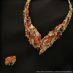 coral, shell, and diamonds set in gold