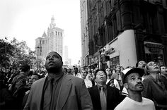 A Knot Of Bystanders At Park Row And Beekman Street Look Up As The South Tower Begins To Collapse