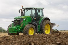 John Deere 6210r Tractor plowing British countryside, Photography & stock images