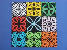 Paper Quilts made in Term 2. We learned to fold paper squares and cut intricate patterns into them to create symmetrical designs. These quilts are based on Cook Island tivaevae. | room seven kowhai