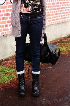 Rolled skinny jeans, combat boots, graphic tee, oversize knit cardigan, big leather purse