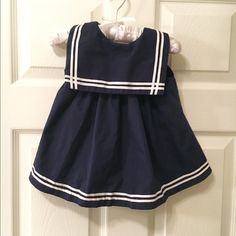 Baby girl's sailor style dress, size 6-9 mos. Sophie Rose brand, baby girl's sailor style dress with matching boy shorts. Navy blue with white stripes and red bow accent. Bibbed  front, cute detailed sailor buttons (3rd picture). Size 6-9 months. Excellent condition, probably only worn a handful of time. No flaws! Other related items available! Dresses