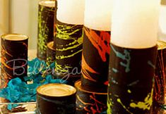 Black painted tins can with colorful splats
