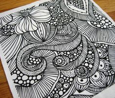 I particularly like the flower in the upper left, but the simplicity of the entire doodle is appealing.