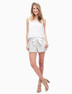 This white romper is the best of both worlds for summer - looks like a two piece set but is the comfort of a romper - all with a bow on top! Click through to shop it just in time for your next summer trip!