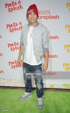 Singer Austin Mahone arrives at the Aquafina FlavorSplash Launch Party at Sony Pictures Studios on October 15, 2013 in Culver City, California.