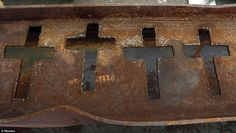 Remembrance: Crosses have been cut from this twisted and corroded beam, pulled from the 9/11 site