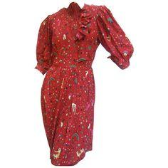 Preowned Emanuel Ungaro Paris Crimson Silk Circus Print Dress Size 6 C... ($275) ❤ liked on Polyvore featuring dresses, red, red silk dress, ruffle dress, silk dress, silk print dress and red pleated dress