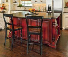 Love the red paint w/ dark glaze island! Vivid statement against white/cream cabinets.
