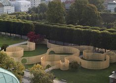 Trylletromler wooden installation that looks like a maze by FABRIC