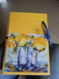 Encadernação de tecido com papel e fita mimosa.