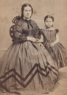 Girl in classic style dress. [Note how the stripe has been pleated in the bodice.]