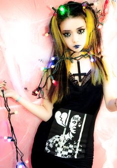 """Nude N' Rude has made a name for themselves in Japan with their Tokyo boutique catering to Japanese fans of edgy dark fashion. Nude N' Rude calls their philosophy """"Bright Despair"""". The exact genre of the fashion is hard to describe – mixing elements of """"scene kid"""" culture (Audrey Kitch, Jeffree Star, etc.), fetish & bondagewear, emo, gothic, horror, Japanese kawaii, and more. Nude N' Rude Koenji is more than just a shop. It's also a shrine to all things alternative, and a gathering place for…"""