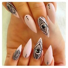 The nails scream tribal and i love the line work. This has inspired me to use lines in my research and make sure that my look has a tribal effect. By placing this on my pixie look, it will be a unique look. There is nothing i don't like about these nails. I will be looking at using nail art in my work.