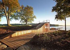 This wooden observation platform and pavilion folds up from the landscape of a memorial park in Koknese, Latvia, offering views across the River Daugava.
