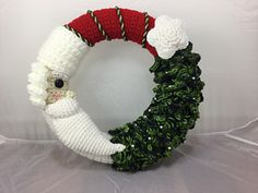This is my latest wreath design :) just in time for Christmas. A Santa and Christmas Tree Wreath. The tree has silver beads , so when the light hits it just right, it looks like it is twinkling,