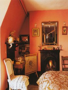 Tangerine walls and Fortuny fabric...and that fabulous fire! Awesome.The home of Jane Wildgoose, The World of Interiors. fortuny.com