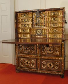 Spanish Vargueno: 17th century walnut and bone vargueno with painted and gilded decoration, the fall front with good original metal work and the cabinet standing on a fitted chest.