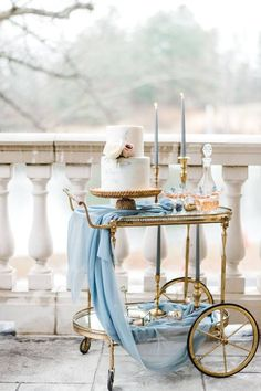 Vintage + romantic style dessert display - Gold cart + baby blue cloth + taper candles + wedding cake SRS Events Informations About SRS Events - Planning - Washington, DC - WeddingWire Pin You can eas Elegant Wedding Cakes, Romantic Weddings, Elegant Cakes, Candles Wedding, Baby Blue Weddings, Baby Blue Wedding Theme, Wedding Colors, Blue Candles, Taper Candles