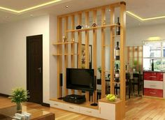 This simple and awesome divider is useful as well as beautiful. The room is separated with long vertical wooden columns and the provision of shelves and media cabinet is an added advantage. Room Design, House Interior, Wooden Columns, Small Spaces, Living Room Divider, Home, Interior, Living Room Designs